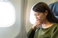Worried woman on a plane.